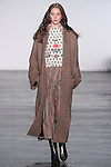 """Model Karime walks runway in a knit jacquard mock turtleneck top with parasol flower embroiderey, striped corduroy gaucho, and wool coat in light brown, from the Vivienne Tam Fall Winter 2016 """"Cultural Dreamland The New Silk Road"""" collection, presented at NYFW: The Shows Fall 2016, during New York Fashion Week Fall 2016."""