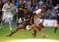 Saturday, 20 October 2012<br /> Pictured: Jonathan de Guzman of Swansea (R) challenged by Jean Beausejour (L) of Wigan<br /> Re: Barclays Premier League, Swansea City FC v Wigan Athletic at the Liberty Stadium, south Wales.