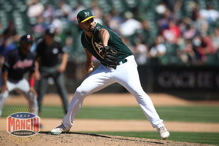 OAKLAND, CA - JUNE 30:  Lou Trivino #62 of the Oakland Athletics pitches against the Cleveland Indians during the game at the Oakland Coliseum on Saturday, June 30, 2018 in Oakland, California. (Photo by Brad Mangin)