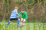 Tommy Feehan Castleisland skips past Patrick McCarthy QPR during their league clash in Castleisland on Sunday