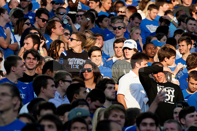 Fans block out the sun during the second half of the game between the Kentucky Wildcats and the Mississippi State Bulldogs at Commonwealth Stadium on Saturday, October 25, 2014 in Lexington, Ky. Mississippi State defeated Kentucky 45-31.Photo by Michael Reaves | Staff