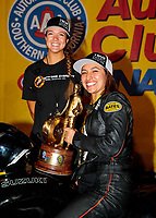 Nov 17, 2019; Pomona, CA, USA; NHRA pro stock motorcycle rider Jianna Salinas celebrates with crew after winning the Auto Club Finals at Auto Club Raceway at Pomona. Mandatory Credit: Mark J. Rebilas-USA TODAY Sports