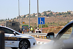 Israeli security forces inspect the site of a car-ramming attack near the Jewish settlement of Elazar south of Bethlehem in the occupied West Bank,  August 16, 2019. Two Israeli youths were wounded in a car-ramming attack near a West Bank bus stop on Friday, Israeli military said. Photo by Mosab Shawer