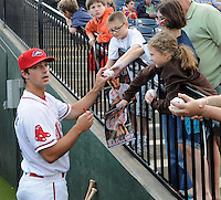 Outfielder Lucas LeBlanc (22) of the Greenville Drive signs autographs prior to a game against the Lakewood BlueClaws on Opening Day, April 5, 2012, at Fluor Field at the West End in Greenville, South Carolina. (Tom Priddy/Four Seam Images)