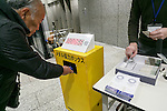 A man donates his old mobile phone to make medals for the 2020 Tokyo Olympic and Paralympic Games at Tokyo Metropolitan Government Building on February 21, 2017, Tokyo, Japan. Tokyo Government has asked for people to donate their old electronic gadgets (including smart phones, mobile phones and tablets) with the aim of collecting and recycling eight tonnes of gold, silver and bronze to make the 5,000 medals needed for the 2020 Tokyo Olympic and Paralympic Games. The recycling campaign started on Thursday, February 16. (Photo by Rodrigo Reyes Marin/AFLO)