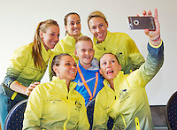 April 17, 2015, Netherlands, Den Bosch, Maaspoort, Fedcup Netherlands-Australia,  jong boy who asked questions in the Cityhall duringthe draw ceremony goes on a selfy with the Australian team<br /> Photo: Tennisimages/Henk Koster