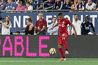 FOXBOROUGH, MA - AUGUST 31: Auro Jr #96 of Toronto FC collects a pass during a game between Toronto FC and New England Revolution at Gillette Stadium on August 31, 2019 in Foxborough, Massachusetts.
