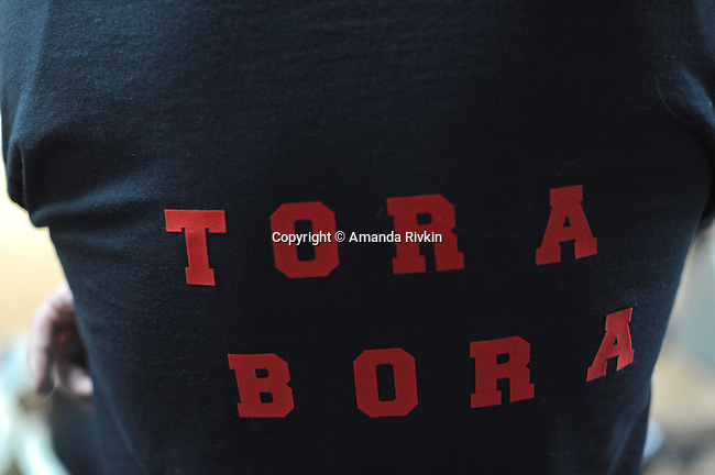 "A member of the bowling team ""Tora Bora"" sports his team bowling shirt while waiting his turn in the Afghan Bowling Tournament in Annandale, Virginia on February 28, 2010."