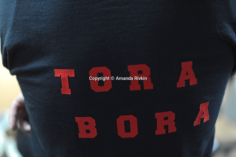 """A member of the bowling team """"Tora Bora"""" sports his team bowling shirt while waiting his turn in the Afghan Bowling Tournament in Annandale, Virginia on February 28, 2010."""