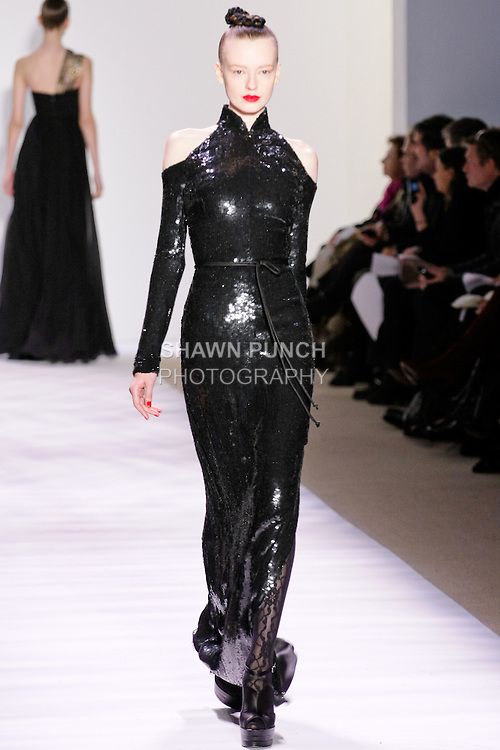 Anastasia Kuznetsova walks the runway in a noir sequin long sleeve cheongsam column gown, by Monique Lhuillier for her Monique Lhuillier Fall 2010 collection, during the Mercedes-Benz Fashion Week Fall 2010.