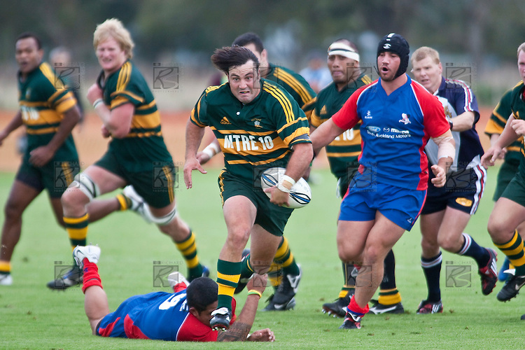 Armun Sanders sprints towards the tryline leaving  Amos Mataia clutching at fresh air.  Counties Manukau Premier Club Rugby game between Ardmore Marist and Pukekohe played at Bruce Pulman Park on Saturday April 17th..Pukekohe won the game 25 - 0 after leading 15 - 0 at halftime.