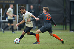 Bruno Lapa (10) of the Wake Forest Demon Deacons keeps the ball away from Burke Bender (29) of the Virginia Tech Hokies during second half action at Spry Soccer Stadium on November 5, 2017 in Winston-Salem, North Carolina.  The Demon Deacons defeated the Hokies 3-0.  (Brian Westerholt/Sports On Film)