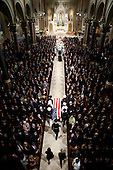 """Boston, NA - August 29, 2009 -- United States Senator Edward M. """"Ted"""" Kennedy's (Democrat of Massachusetts) flag-draped coffin is carried into Our Lady of Perpetual Help Basilica in Boston, during the funeral service August 29, 2009. .Mandatory Credit: Chuck Kennedy - White House via CNP"""