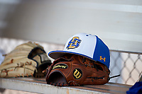 South Dakota State Jackrabbits hat and Wilson glove on the bench during a game against the Northeastern Huskies on February 23, 2019 at North Charlotte Regional Park in Port Charlotte, Florida.  Northeastern defeated South Dakota State 12-9.  (Mike Janes/Four Seam Images)