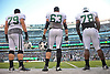 New York Jets teammates Brent Qvale #79, left, Jeff Adams #63, center and Jonotthan Harrison get ready for the team's annual Green & White practice and scrimmage at MetLife Stadium in East Rutherford, NJ on Saturday, Aug. 5, 2017.