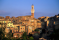 BELL TOWER of the PALAZZO PUBBLICO dominates the skyline of SIENA - TUSCANY, ITALY