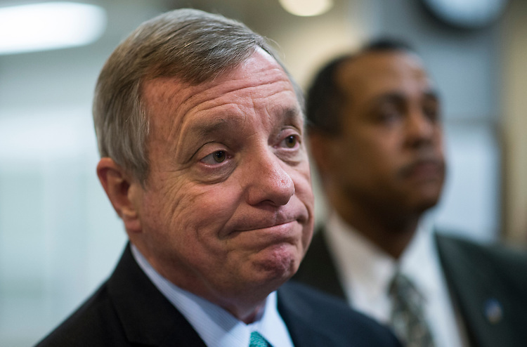 UNITED STATES - JUNE 11: Sen. Richard Durbin, D-Ill., speaks with reporters as he makes his way from the Senate subway to the Capitol for the weekly policy lunch on Tuesday, June 11, 2013.  (Photo By Bill Clark/CQ Roll Call)