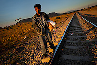 """A Guatemalan immigrant waits on the railroad track to climb up the cargo train passing through the train station in Huehuetoca, Mexico, 7 November 2014. Between 2010 and 2015, the US and Mexico have apprehended almost 1 million illegal immigrants from El Salvador, Honduras, and Guatemala. While the economic reasons remain the most frequent motivation for people from Central America to illegally immigrate to the US, thousands of Salvadorans, Guatemalans, and Hondurans, many of them minors, seek asylum in the US due to the thriving crime and gang-related violence in their region (known as the Northern Triangle). Taking an exhausting and risky journey, riding thousands of miles atop the cargo trains, facing a physical danger and extortion from the organized crime groups that control migrant routes, the """"undocumented"""" still flee to the US, looking for their American dream."""
