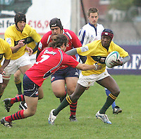 Zimbabwe scrum half Ryan Manyika makes a break against Chile during the 7th place play-off in Division B of the Under 19 Rugby World Championship at Gibson Park Malone 2007.