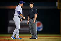 Pensacola Blue Wahoos manager Pat Kelly (33) argues with first base umpire Matt Winter during a game against the Mobile BayBears on April 25, 2017 at Hank Aaron Stadium in Mobile, Alabama.  Mobile defeated Pensacola 3-0.  (Mike Janes/Four Seam Images)