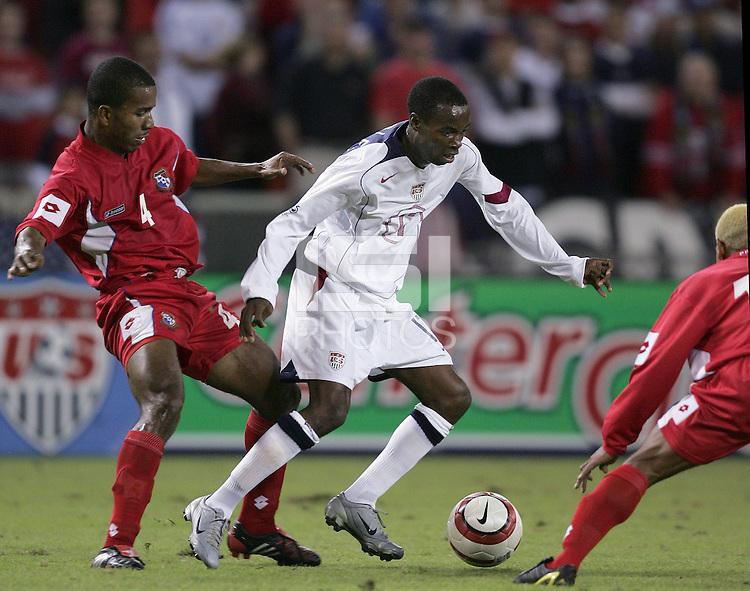 Luis Henriquez, left, DaMarcus Beasley, right, Panama vs USA, World Cup qualifier at RFK Stadium, 2004.