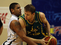 Boomer guard Brad Newley tries to get past Corey Webster during the International basketball match between the NZ Tall Blacks and Australian Boomers at TSB Bank Arena, Wellington, New Zealand on 25 August 2009. Photo: Dave Lintott / lintottphoto.co.nz