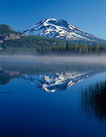ORCAC_051 - USA, Oregon, Deschutes National Forest, South Sister reflects in the misty waters of Sparks Lake in early morning.