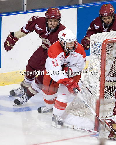 Carl Sneep (BC - 7), Carter Camper (Miami - 11), Dan Bertram (BC - 22) - The Boston College Eagles defeated the Miami University RedHawks 4-3 in overtime on Sunday, March 30, 2008 in the NCAA Northeast Regional Final at the DCU Center in Worcester, Massachusetts.