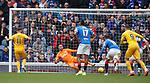 14.09.2019 Rangers v Livingston: Steven Lawless slots his penalty kick past Allan McGregor