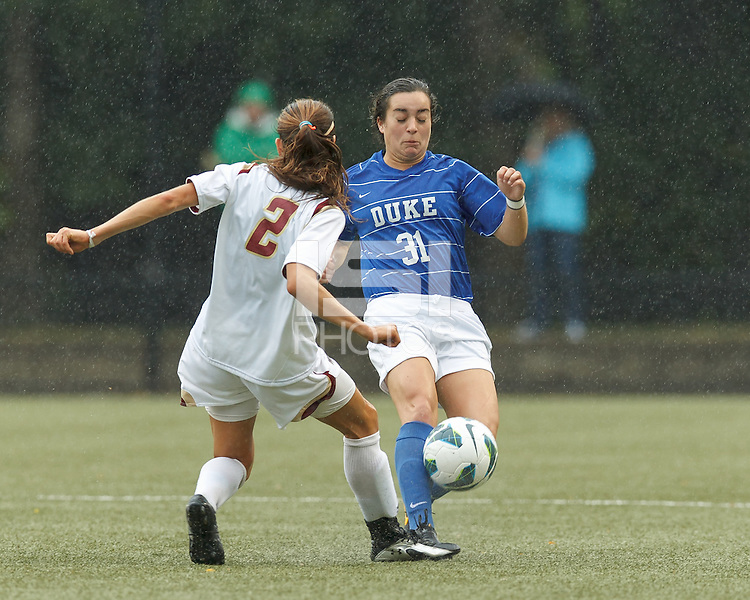 Duke University defender Christina Gibbons (31) passes the ball.Boston College (white) defeated Duke University (blue/white), 4-1, at Newton Campus Field, on October 6, 2013.