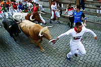 First San Fermin bull running.