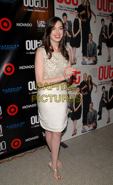 "ANNE HATHAWAY.""Out""Magazine honors 100 most influential people in gay culture during ""Out 100 Awards"" at Capitale, New York, NY, USA, 10 November 2006..full length ann white cream top skirt  gold beaded strappy sandals shoes hands together red lipstick.Ref: ADM/PH.www.capitalpictures.com.sales@capitalpictures.com.©Paul Hawthorne/AdMedia/Capital Pictures. *** Local Caption ***"