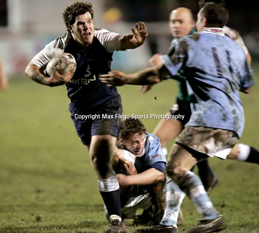 Oxford University / Cambridge University.The 25th Pcubed Student Rugby League Varsity Match.Richmond Athletic Ground, March 2, 2005.Pic : Max Flego ...Oxford's Ben Dunnett fends off Cambridge's Richard Draycott