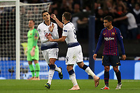 Erik Lamela of Tottenham Hotspur is congratulated after scoring the second goal during Tottenham Hotspur vs FC Barcelona, UEFA Champions League Football at Wembley Stadium on 3rd October 2018