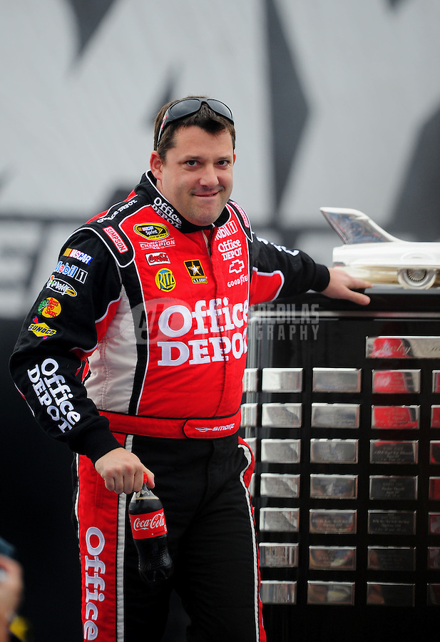 Feb. 26, 2012; Daytona Beach, FL, USA; NASCAR Sprint Cup Series driver Tony Stewart touches the Harley J. Earl Trophy during driver introductions prior to the Daytona 500 at Daytona International Speedway. Mandatory Credit: Mark J. Rebilas-