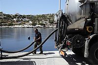 "Pictured: Specialist crew clean up the oil spill that has reached the coast of Salamina, Greece<br /> Re: An oil spill off Salamina island's eastern coast is spreading and has become ""an environmental disaster"" according to local authorities in Greece.<br /> The spill was caused by the sinking of the Aghia Zoni II tanker, carrying 2,200 metric tons of fuel oil and 370 metric tons of marine gas oil on Saturday, southwest of the islet of Atalanti near Psytalleia. According to reports, the coastline stretching from Kinosoura to the Selinia community has ""turned black"" and authorities fear a new leak from the sunken ship.<br /> According to the island's mayor, Isidora Papathanasiou, the weather ""turned on Sunday afternoon and brought the oil spill to Salamina."""