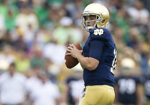 August 31, 2013:  Notre Dame Fighting Irish quarterback Tommy Rees (11) sets in the pocket during NCAA Football game action between the Notre Dame Fighting Irish and the Temple Owls at Notre Dame Stadium in South Bend, Indiana.  Notre Dame defeated Temple 28-6.