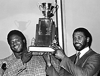 Oakland Raiders Henry Lawrence (left)holding the Lineman of the year trophy for 1981 along with Rod Martin. (photo/Ron Riesterer)