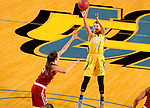 BROOKINGS, SD - DECEMBER 6: Macy Miller #12 from South Dakota State spots up for a jumper over Maddie Manning #23 from Oklahoma during their game Wednesday night at Frost Arena in Brookings. (Photo by Dave Eggen/Inertia)