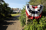Patriotic summer home in Eagles Mere with swags and flags.