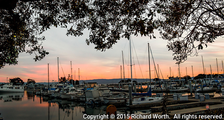 """According to legend, this sunset bodes well for sailors who'll launch their boats in the morning """" Red sky at night, sailor's delight. . . """"  San Leandro Marina on San Francisco Bay, on March 14th - Pie Day, 2015."""