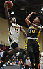 Rolando Meyers-Turner #15 of Uniondale, left, soars through the air as Jordan Redd #10 of Westbury contests his drive during the Nassau County varsity boys basketball Class AA semifinals at Farmingdale State College on Monday, Feb. 26, 2018. Top-seeded Uniondale won by a score of 61-44.
