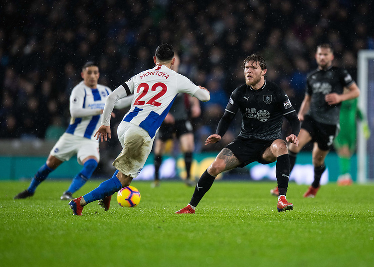 Brighton & Hove Albion's Martin Montoya (left) under pressure from Burnley's Jeff Hendrick (right) <br /> <br /> Photographer David Horton/CameraSport<br /> <br /> The Premier League - Brighton and Hove Albion v Burnley - Saturday 9th February 2019 - The Amex Stadium - Brighton<br /> <br /> World Copyright © 2019 CameraSport. All rights reserved. 43 Linden Ave. Countesthorpe. Leicester. England. LE8 5PG - Tel: +44 (0) 116 277 4147 - admin@camerasport.com - www.camerasport.com