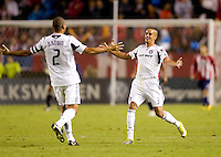 Chicago Fire forward Calen Carr celebrates with open arms with teammate C.J. Brown after scoring a goal. The Chicago Fire defeated CD Chivas USA 3-1 at Home Depot Center stadium in Carson, California on Saturday October 23, 2010.