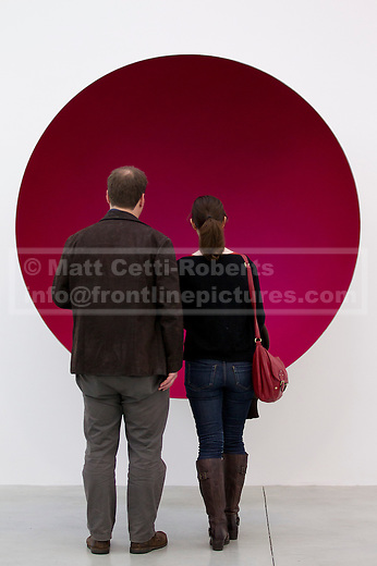 09/10/2012. LONDON, UK.  Two gallery visitors view Anish Kapoor's sculpture 'Hollow' (2012) at a press view ahead of his new exhibition at the Lisson Gallery in London today (09/12/12) . The exhibition, the first since the artists solo exhibition at the Royal Academy of the Arts in 2009, features new works by Kapoor and runs from the 10th of October to the 10th of November 2012. Photo credit: Matt Cetti-Roberts