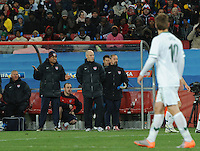 Coach Bob Bradley and the U.S. bench follow the intensity of the match during the second half. The United States came from a 2-0 halftime deficit to Slovenia to earn a 2-2 draw their second match of play in Group C of the 2010 FIFA World Cup.