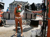Marisa Antonelli  of Brazil  splashing with water during the FIVB Beach Volleyball World Championships female match between Switzerland  vs Brrazil l  at  on July 1 , 2015 in Amsterdam, Netherlands. Photo by Paulo Amorim