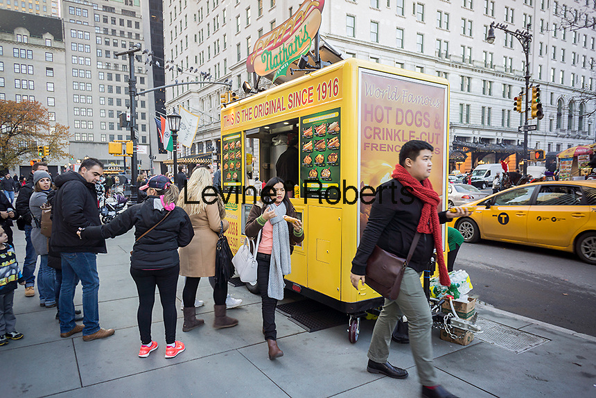 Breaking away from Coney Island a Nathan's Famous branded food cart sells their franks in New York, seen on Sunday, December 6, 2015.  (© Richard B. Levine)