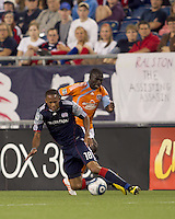 New England Revolution forward Khano Smith (18) succumbs to pressure by Houston Dynamo midfielder Anthony Obodai (35). The New England Revolution defeated Houston Dynamo, 1-0, at Gillette Stadium on August 14, 2010.