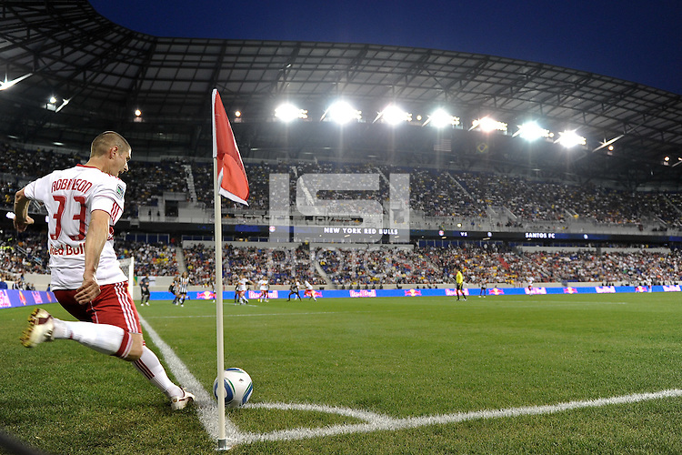 Carl Robinson (33) of the New York Red Bulls takes a corner kick during the first half of a friendly between Sanots FC and the New York Red Bulls at Red Bull Arena in Harrison, NJ, on March 20, 2010. The Red Bulls defeated Santos FC 3-1.